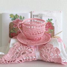 Crochet tea cup -- I could use these as dishes with small plastic containers inside them to hold food items on the day. Also I could do some as take home gifts with different tea bags inside.