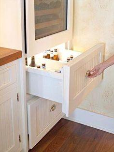 Beer drawer under a wine fridge by marta