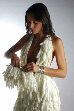 Sebastion E. designed a dress made of latex gloves