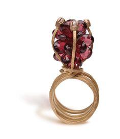 Ring |  Donna Brennan. 18 k gold, garnets and rough diamonds