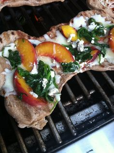 Grilled whole wheat pizza with garlic, spinach, peach, goat cheese and mozzarella