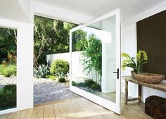 Patrick Dempsey Malibu house garden doorway ; Gardenista that huge pivot door