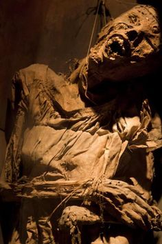 China girl in a casket in the museum with threads holding up her head | Mummies Museum | Mexico