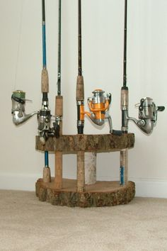 Rustic Home decor Fishing Rod Reel Holder Birch wood Log Tree Slice Cabin pole display Pool cue stand. $40.00, via Etsy.