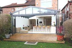 Modern glass and aluminum conservatory extending an English home