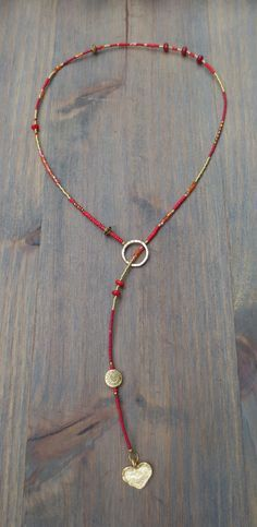 Beaded Lariat Necklace Christie Lariat in red, orange and gold Miyuki seedbeads, red coral beads, gold plated disc bead with gold plated hammer. Wire Jewelry, Boho Jewelry, Jewelry Crafts, Beaded Jewelry, Jewelery, Jewelry Necklaces, Fashion Jewelry, Jewelry Design, Jewelry Ideas