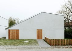 Triendl und Fessler Architekten has completed an affordable home in an Austrian village, featuring a hole in its centre that provides residents with a secluded garden courtyard.