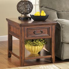 This gorgeous rectangular end table is made from durable oak and select hardwoods. The elegant dark brown finish and vintage style will add a classy touch to your living room.