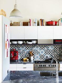 Keep your cookbooks off your living room shelves and keep them where you actually need them.