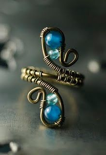 Pretty wire wrap idea for Bo! I want her to make one for me.