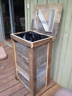 Rustic trash can designed for outdoor kitchen. Made from reclaimed barnwood.
