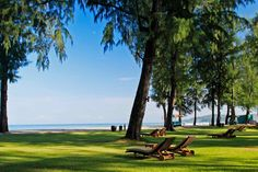 Acres of tropical gardens and caressed by the azure water of the Andaman Sea...