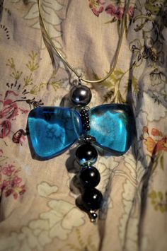 El telefonillo bilingüe, DYI beads dragonfly pendant. My first attempt.
