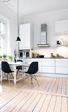 White Scandinavian kitchen with wood floor