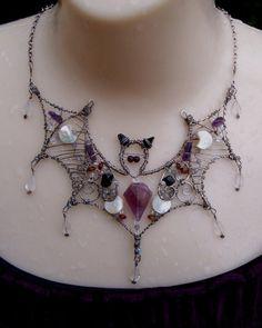 Bat necklace.