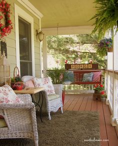I dream of a porch some day....this one has it all...swing and wicker chairs...nirvana