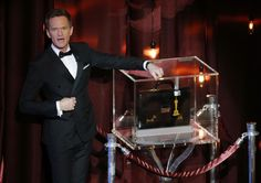 Host Neil Patrick Harris stands next to a sealed briefcase holding his predictions of the Oscar winners during the 87th Academy Awards in Hollywood, California February 22, 2015. REUTERS/Mike Blake