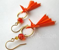 Origami phoenix earrings in orange paper. They're long, lightweight, and surprisingly sturdy!