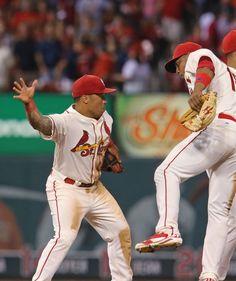 Kolten Wong and Oscar Traveras exchange congrats when Cards beat the Brewers 9-7. 8-2-14