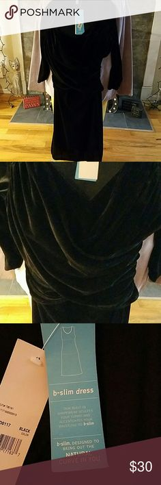 Dress Simple yet elegant black velour dress with 3/4 sleeves. V-neck with criss cross effect bodice to waistline. Designed to bring out the natural curve in you!! b slim Dresses