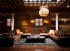 Loft decor can often be too spare. This makes use of a dreamily-large space in the best way. Plush fabric and generous seating = quality time with a heap of your friends.