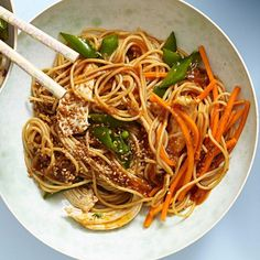 """Classic sesame noodles become a healthy meal with lean chicken and tons of veggies in this quick recipe for Asian noodles. Be sure to rinse the spaghetti until it's cold, then give it a good shake in the colander until it's well drained. Are you a spiralizing pro? Swap 5 cups of raw zucchini, carrot or other veggie """"noodles"""" for the cooked pasta."""