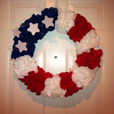 My 4th of July wreath!:) just finished it! It was $12 to make and pretty quick! I was pleased! Looks cool on my door.