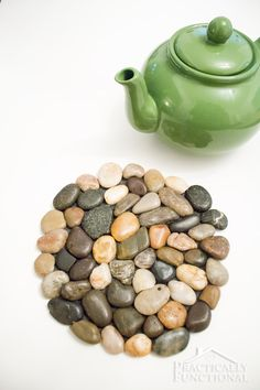 Make your own river rock trivet; all you need is hot glue, felt, and river rocks!