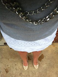 Grey sweater, white eyelet skirt and Stella and Dot chain necklace