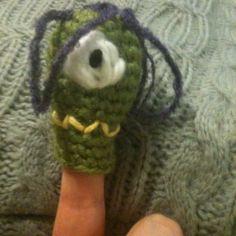 Crochet finger puppet monster.