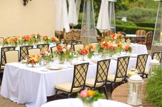 Centerpieces by Briana Maxson Design. Coral, Peach, Gold Wedding. Intimate wedding. Outdoor wedding. Oak Creek Golf Club Wedding.
