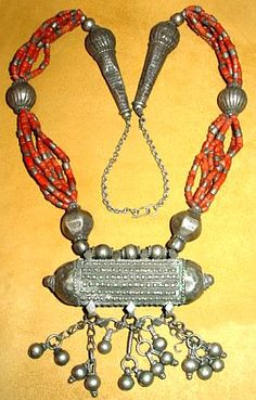 An amazing, museum quality antique silver and red coral necklace from Yemen which was made by Jewish silversmiths. This necklace features seven multiple strands with a large ethnic silver pendant and silver beads. This piece is 26 inches long not measuring the adjustable chain.