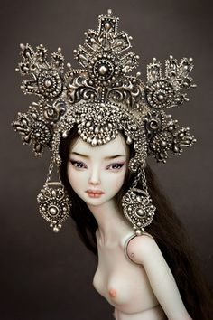 Marina Bychkova creates these ball-jointed porcelain dolls all by hand. She sculpts, molds, fires, paints, strings, sews, beads, jewels, everything.