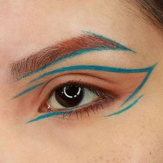 Makeup by Jacquie Bear. Instagram: @bacquiejear. Blue geometric graphic eyeliner with peach eyeshadow. Cruelty free products used by Ben Nye and Makeup Geek.