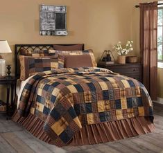 The Patriotic Patch Quilt blends Americana prints with plaids, stripes and checks, lending a relaxed and rustic sophistication. 100% cotton brick layout in deep navy, red and khaki