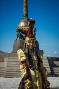 A Tuvan girl in traditional dress by The Center of Asia Monument in Kyzyl, Tuva Republic.