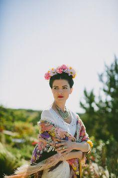 I like the idea of a somewhat classic wedding dress with a colorful Hispanic shawl.