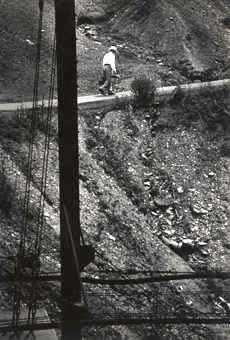 eugene-smith-man-walking-on-hill