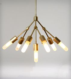 SEVEN Chandelier Fixture by StudioPGRB on Scoutmob Shoppe. A vintage modern design and a soft, glowing shine = yes.