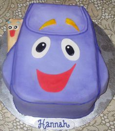 Dora the Explorer, Backpack & The Map 3-D Cake. And it even has Hannah's name on it :)