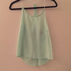H&M T-back Tank Top Only worn once. Great condition. H&M size 4. 100% Polyester H&M Tops Tank Tops