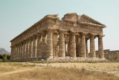 This temple of Hera was built around 550 BC by Greek colonists in the city Paestum, an ancient Greco-Roman city in southern Italy, not far from the beach.  Another nearby temple was built about a century later and was also dedicated to Hera, the goddess of marriage and childbirth. Further away stands a temple dedicated to Athena built in about 500 BC.