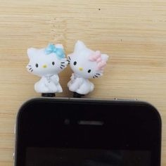 Cute Blue Pink Bowknot Cat Anti Dust Plug - 3.5mm Phone Dust Stopper Earphone Cap Headphone Jack Charm for iPhone 4 4S 5 HTC Samsung. $2.99, via Etsy.