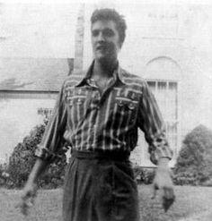 Candid shot of Elvis in front of Graceland, 1957