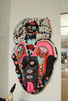 """Elena Stonaker's 'Scope' - """"Stonaker's beaded sculptures look like spiritual altars to imaginary monsters, turning body parts and coded symbols into dazzling tapestries, gargantuan jewelry pieces and soft dolls. The multimedia works, at once girlish and majestic, featured elements of Mike Kelley, Dorothy Iannone and Betsey Johnson."""""""