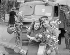 The BEF arrives in France, September - October 1939: A British soldier is greeted with flowers by a French girl at Rouen.