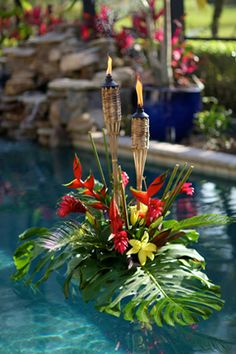 Tropical pool flowers with tiki torches