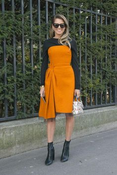 Make a formal, feminine cocktail dress right for a downtown date by layering it over a tee or long-sleeve bodysuit and pulling on ankle boots. This same styling trick can make strapless dresses appropriate for the office or a more casual daytime event.