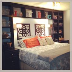 My husband built in this storage unit around our king size bed.  We got rid of night stands and dressers!