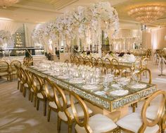 Guests dined at chandelier tables under a canopy of Phalaenopsis orchids at this stunning reception planned by @internationaleventco || Venue: @beverlywilshire | Planner: @internationaleventco | Florist: @c @shishishikevinlee | Photographer: @john_solano_photography | Videographer: @vidicamproductions | Lighting: @images_lighting | Band: @liventgroup Rouge | Décor/Rentals: @palacepartyrental | Photo Booth: @mvsstudio | Cake: @jandlcakes | Dresser: @asitbridal | Fruit Station: #Hasmik | Make…